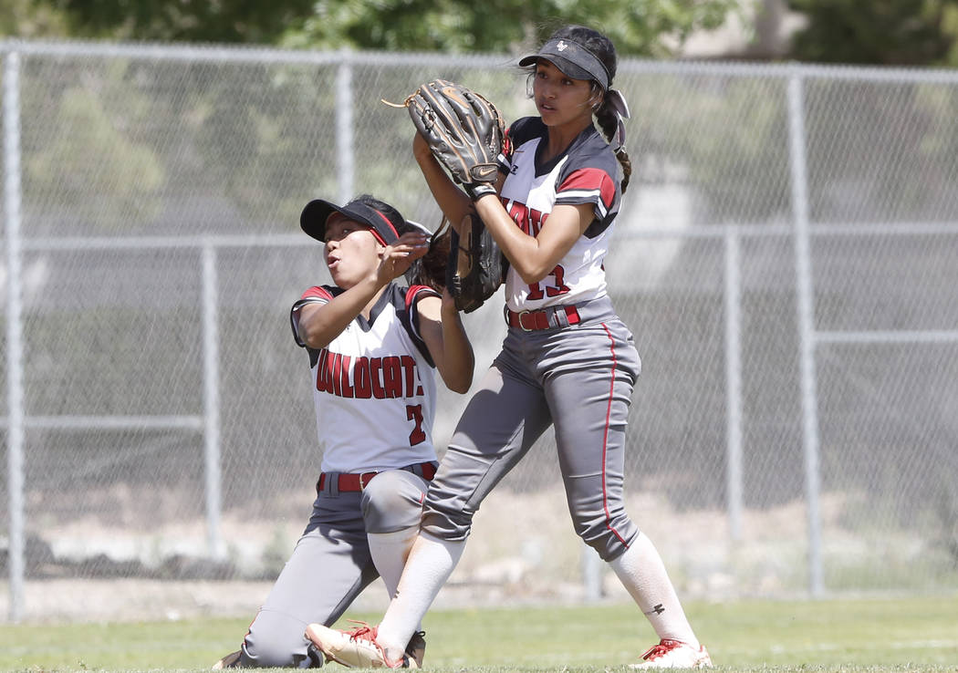 Las Vegas High's Sabrina Saldate, right, collides with her teammate Angelina Visitacion as she catches the ball during their game against Liberty High on Saturday, April 22, 2017, in Henderson. Bi ...