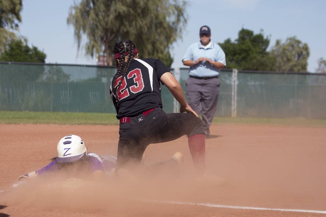 Durango sophomore Kaitlin Fazendin safely slides into third base as Desert Oasis sophomore Makayla Rickard unsuccessfully attempts to tag her out during a gameat Desert Oasis High School on Tuesda ...