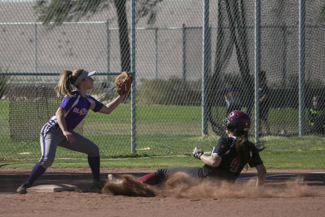 Durango junior Isabel Perez prepares to catch the ball as Desert Oasis sophomore Holly Severance attempts to slide into third base at Desert Oasis High School on Tuesday, April 25, 2017, in Las Ve ...