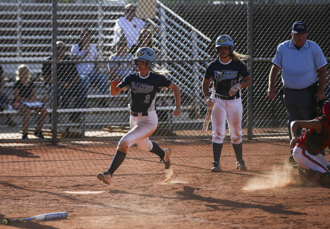 Foothill's Kylie Becker (2) scores a run against Liberty during a baseball game at Liberty High School in Henderson on Wednesday, April 26, 2017. Chase Stevens Las Vegas Review-Journal @csstevensphoto