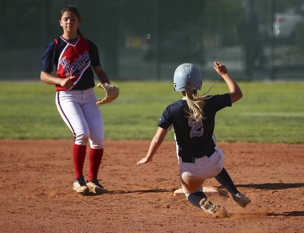 Foothill's Kylie Becker (2) slides safely into second base against Liberty's Ashleigh Rodriguez (13) during a baseball game at Liberty High School in Henderson on Wednesday, April 26, 2017. Chase  ...