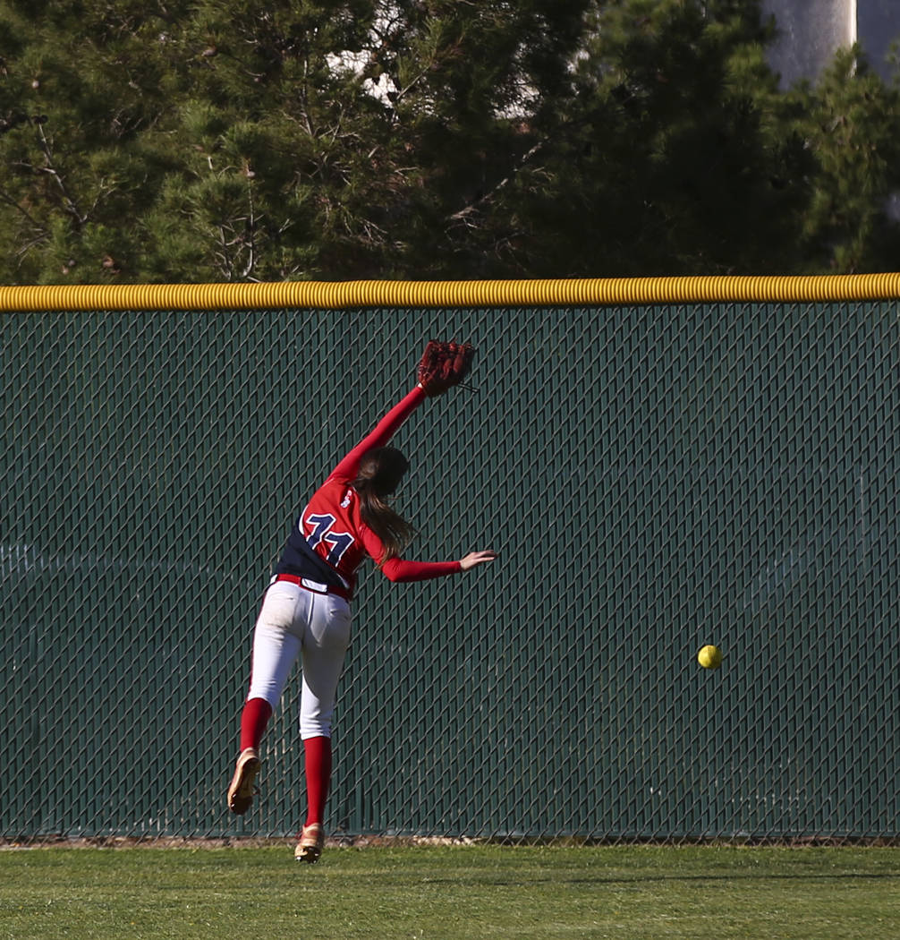 Liberty's Marisa Olmos (11) misses a fly ball from Foothill's Katelyn Enzweiler (27) during a baseball game at Liberty High School in Henderson on Wednesday, April 26, 2017. Chase Stevens Las Vega ...