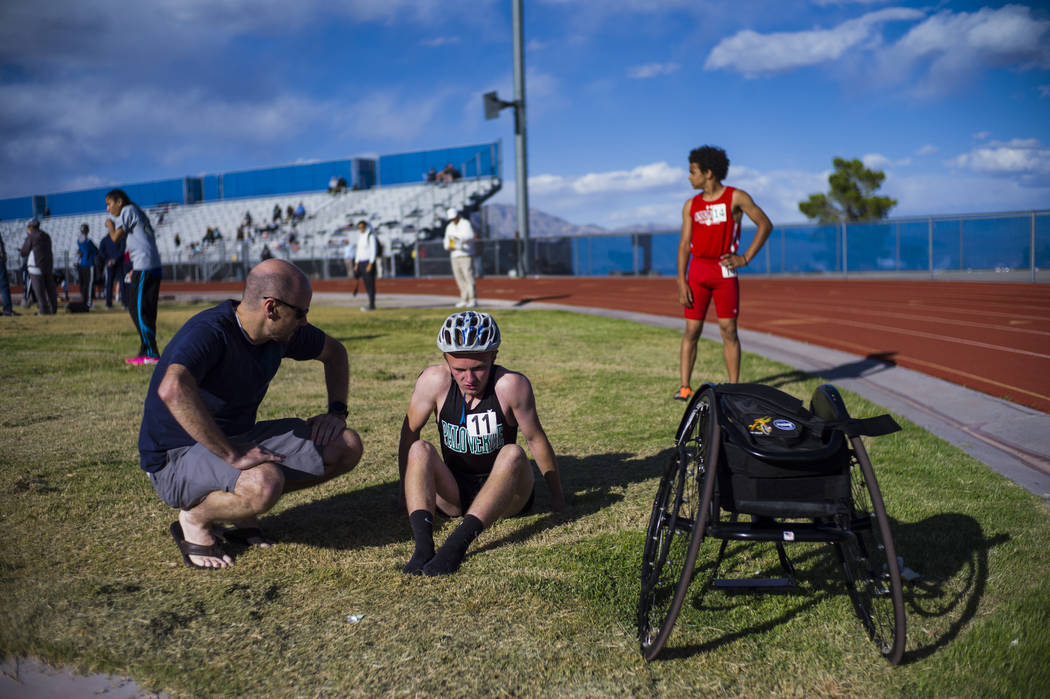 Palo Verde's Ben Slighting, who competes in a wheelchair, talks with his dad, Brad, after the 1600-meter run during a track and field meet at Centennial High School in Las Vegas on Friday, April 2 ...