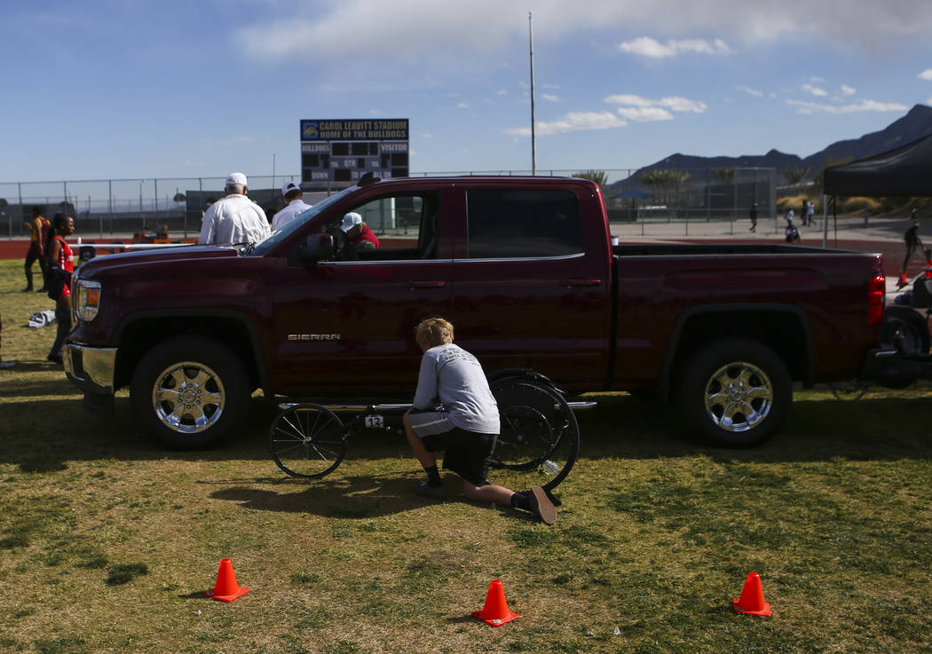 Palo Verde's Ben Slighting checks his wheelchair before competing in the 1600-meter run during a track and field meet at Centennial High School in Las Vegas on Friday, April 28, 2017. Chase Steven ...