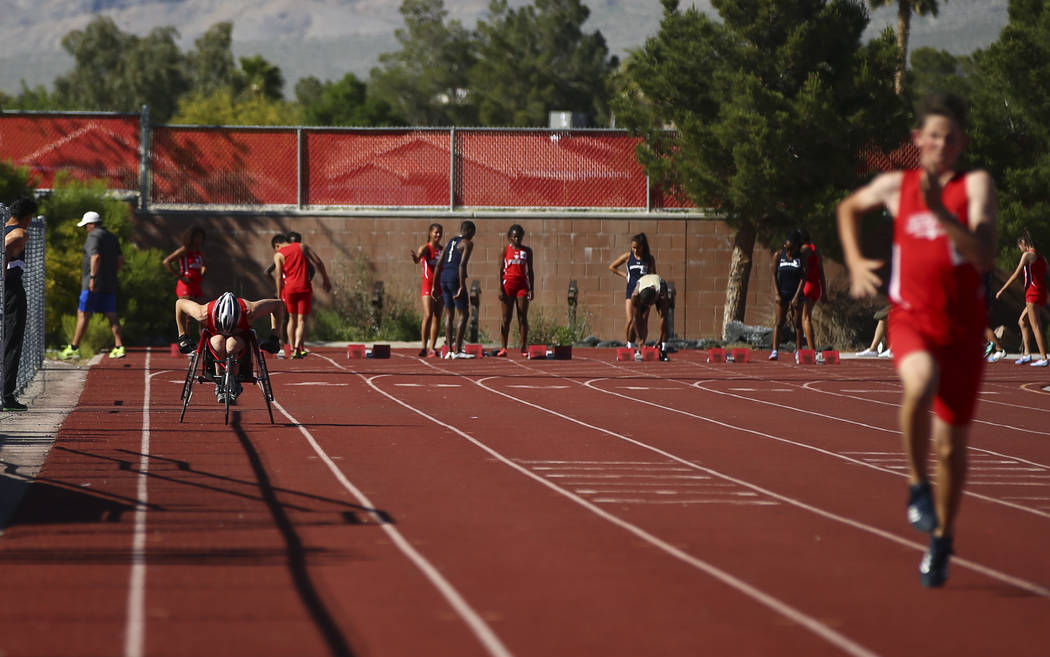 Arbor View freshman Blake Dickinson, far left, competes in the 100-meter dash during a track and field meet at Arbor View High School in Las Vegas on Wednesday, April 19, 2017. Chase Stevens Las V ...
