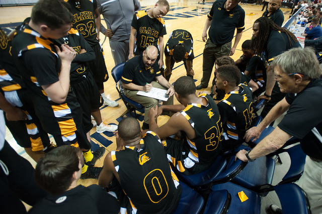 Chad Beeten, Head Coach for Clark High School basketball varsity team, gives advice in the final minutes against Elko High School during the Division I -A state finals on Saturday, March 1, 2014 i ...