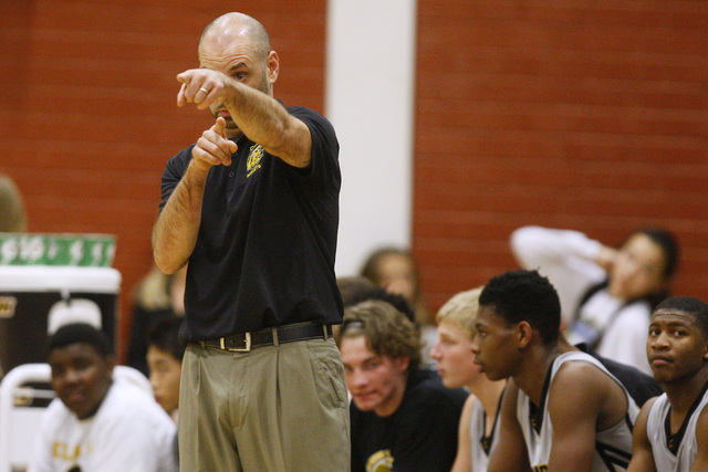 Clark head coach Chad Beeten positions his players during their game against  Faith Lutheran Thursday, Feb. 12, 2015 at Clark. Clark won 64-49. (Sam Morris/Las Vegas Review-Journal)