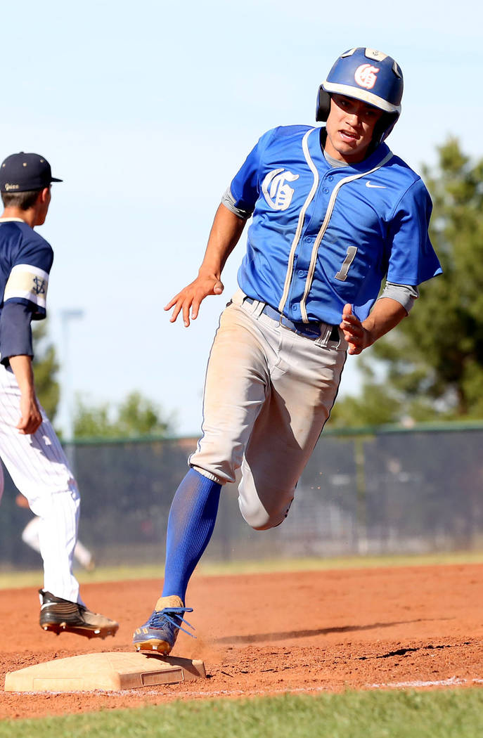 Bishop Gorman's Jorel Hingada rounds the third base to successfully make it home in the fourth inning against Spring Valley at Spring Valley High School in Las Vegas, Tuesday, May 2, 2017. Elizabe ...