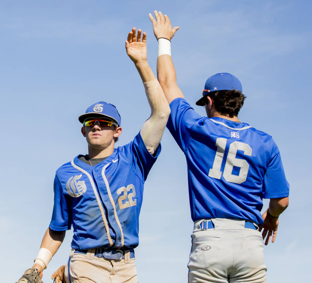 Bishop Gorman's Braxton Wehrle (22), left, and Austin Wells (16), high-five during a game against Spring Valley at Spring Valley High School in Las Vegas, Tuesday, May 2, 2017. Elizabeth Brumley L ...