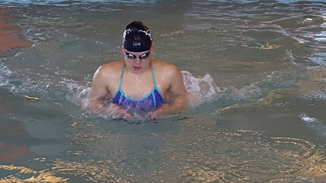 Legacy senior Joelle Beachler, who has severe hearing loss in both ears, finished seventh in the 100-yard breaststroke at the Nevada Interscholastic Activities Association state girls swimming and ...