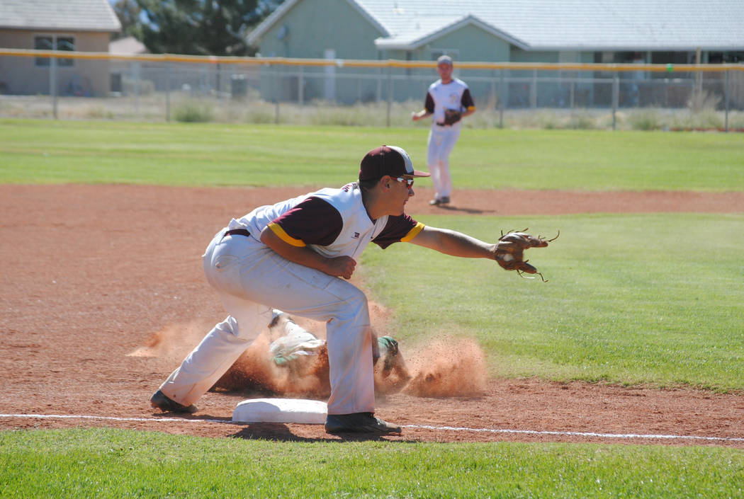 Mojave's Scott Wilson steals third base at Pahrump Valley High School, Thursday, May 4, 2017. The Trojans won 5-2 to claim the Class 3A Sunset League title. (Charlotte Uyeno)