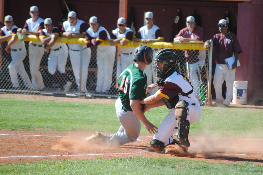 Pahrump Valley catcher Willie Lucas tags out Mojave's Reece McClian at Pahrump Valley High School, Thursday, May 4, 2017. The Trojans won 5-2 to claim the Class 3A Sunset League title. (Charlotte  ...