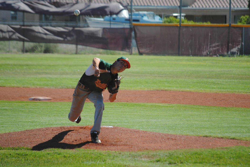 Mojave's Scott Wilson delivers a pitch at Pahrump Valley High School, Thursday, May 4, 2017. The Trojans won 5-2 to claim the Class 3A Sunset League title. (Charlotte Uyeno)