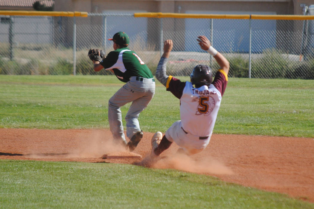 Pahrump Valley's Paker Hart slides safely into second base against Mojave at Pahrump Valley High School, Thursday, May 4, 2017. The Trojans won 5-2 to claim the Class 3A Sunset League title. (Char ...