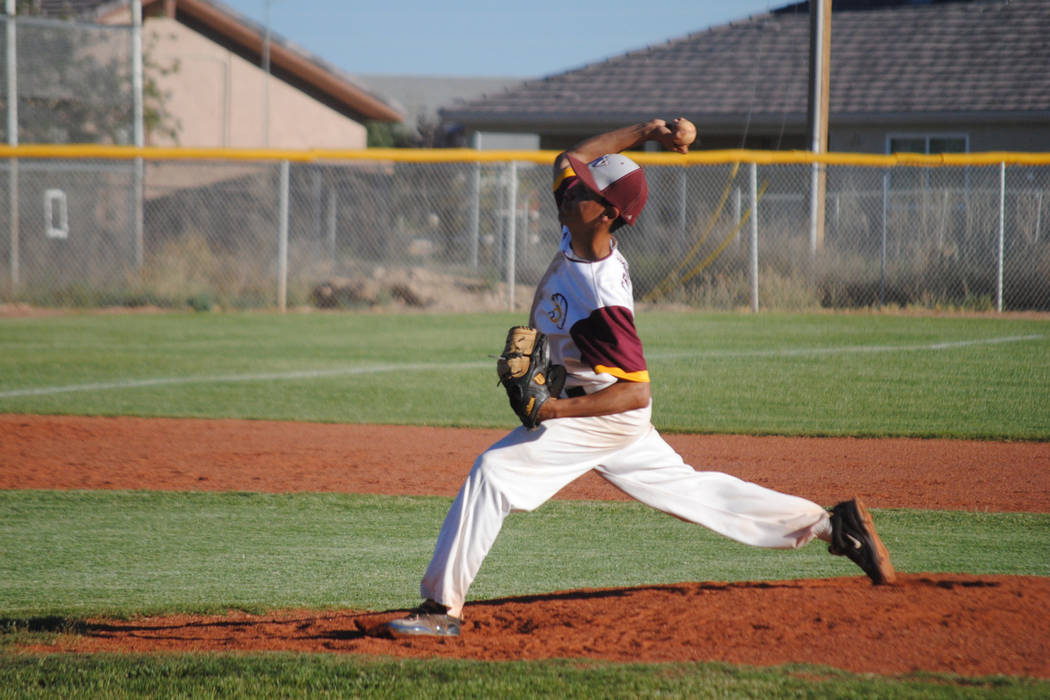 Reliever Josh Ferrer delivers a pitch against Mojaveat Pahrump Valley High School, Thursday, May 4, 2017. The Trojans won 5-2 to claim the Class 3A Sunset League title. (Charlotte Uyeno)