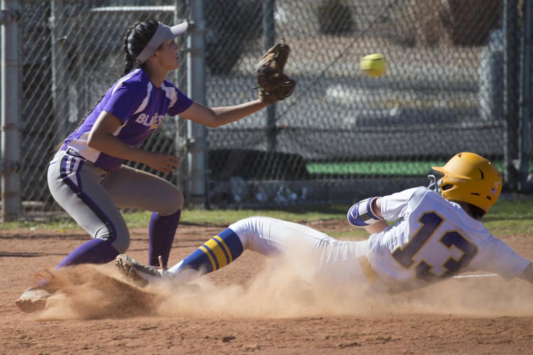 Sierra Vista's Daelynn Hilton (13) slides to home plate for a score against Durango's Keely Thompson (2) at Sierra Vista High School on Thursday, May 4, 2017, in Las Vegas. Sierra Vista won 8-1. E ...