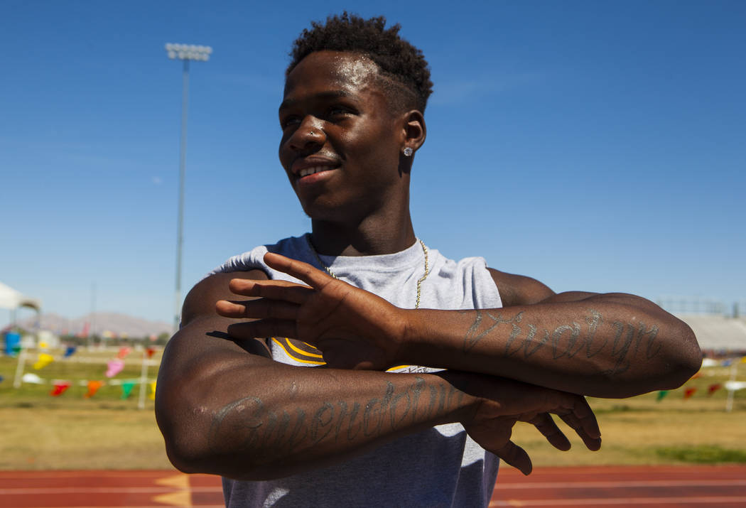 R.J. McCarter displays his tattoos with his mother and grandmother's names during track practice at Bonanza High School in Las Vegas on Thursday, May 4, 2017. Miranda Alam Las Vegas Review-Journal ...