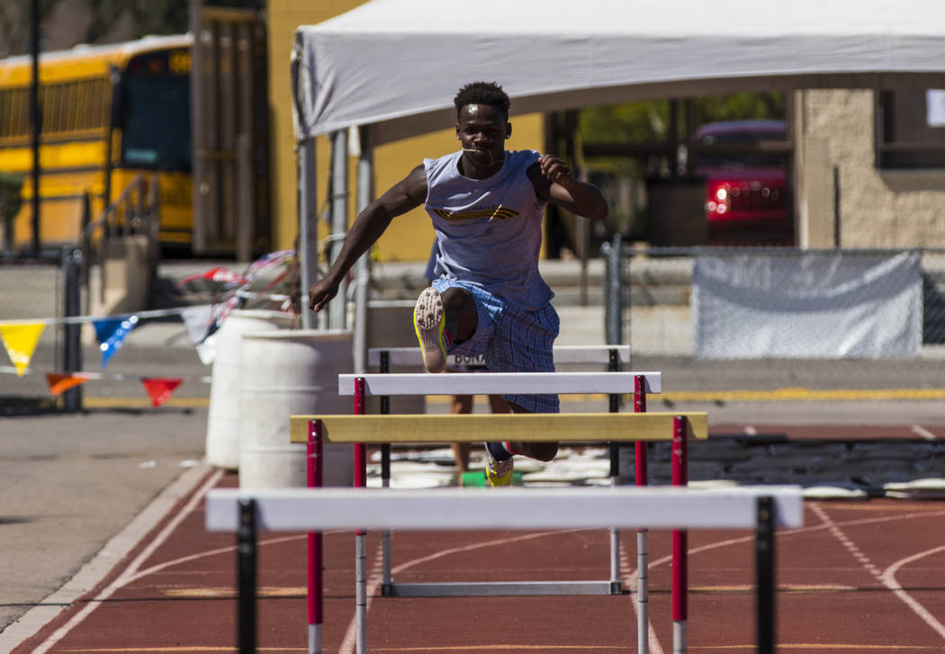 R.J. McCarter jumps hurdles during track practice at Bonanza High School in Las Vegas on Thursday, May 4, 2017. Miranda Alam Las Vegas Review-Journal @miranda_alam