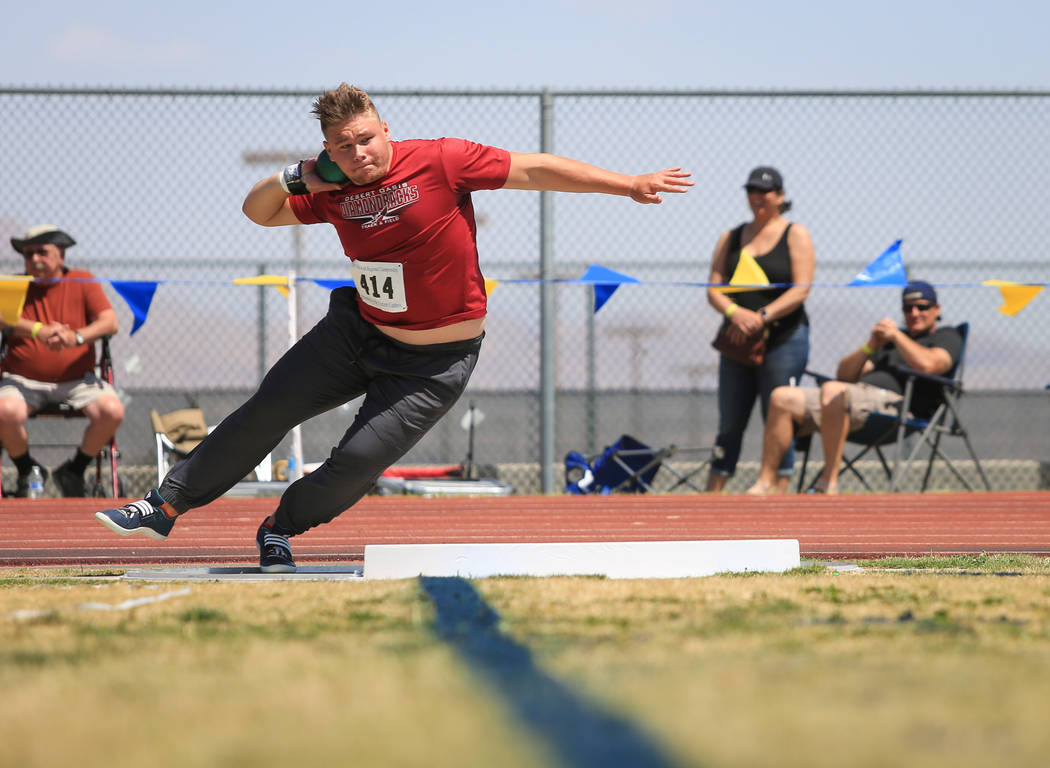 Nick Benham, a senior from Desert Oasis High School, throws shot put during the 4A Sunset and Sunrise region track meet at Foothill High School in Henderson on Saturday, May 6, 2017. Benham's long ...