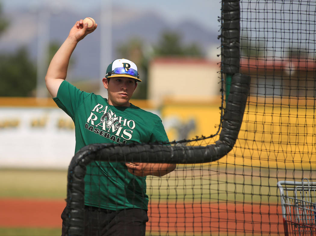 Rancho head coach Manny Llamas throws a batting practice session with catchers during practice at Rancho High School on Friday, May 5, 2017, in Las Vegas. Brett Le Blanc Las Vegas Review-Journal @ ...
