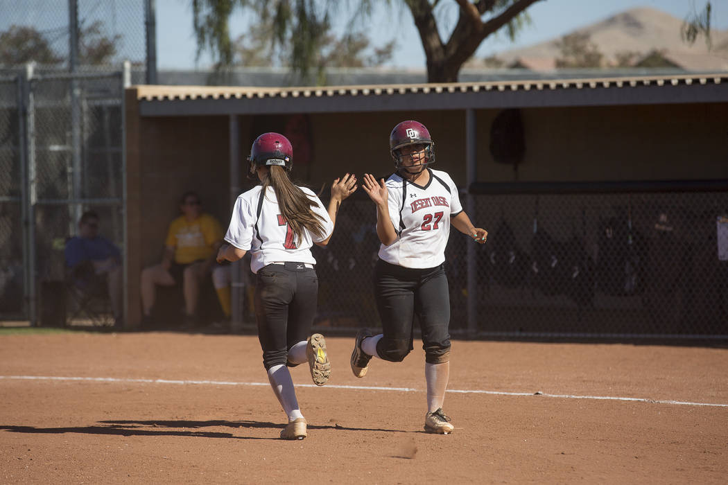 Desert Oasis sophomore Hailey Jaramillo (7) replaces senior Elsy Guzman (27) on first base during a game against Bonanza at Desert Oasis High School on Thursday, May 4, 2017, in Las Vegas. Bridget ...