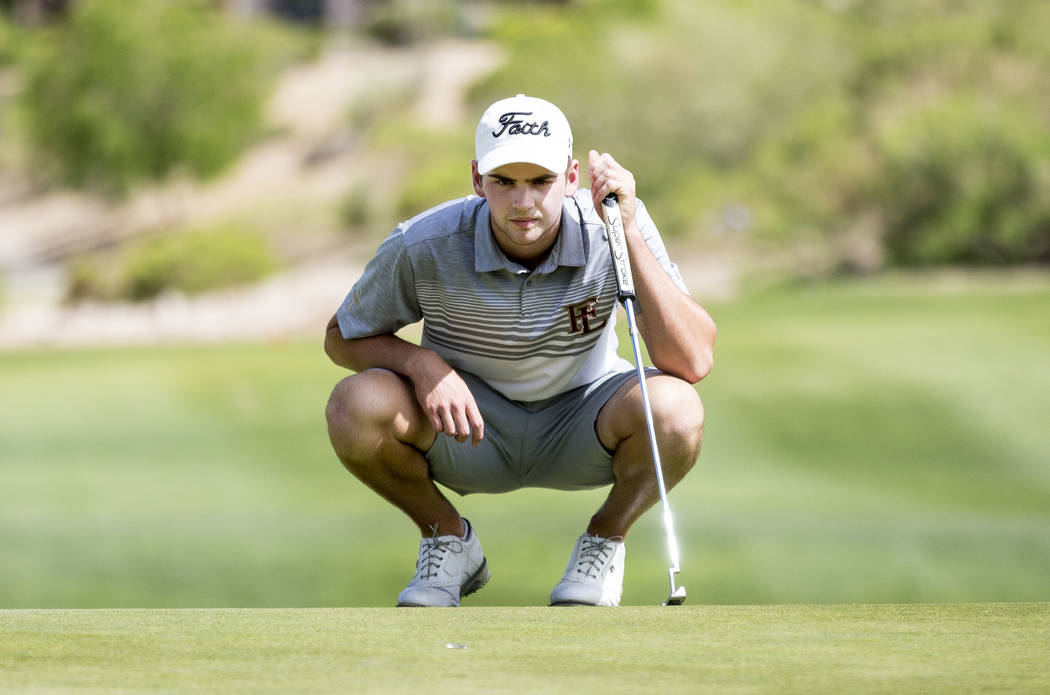 Faith Lutheran's Charlie Magruder lines up his shot on the 18th hole during Sunset Region boys golf tournament at the Siena Golf Club in Las Vegas, Monday, May 8, 2017. (AP Photo/ Elizabeth Brumle ...