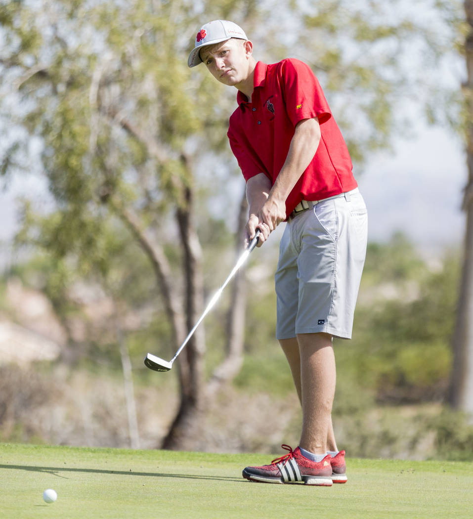 Desert Oasis' Devin Heiman finishes the 17th hole during the Sunset Region boys golf tournament at the  Siena Golf Club in Las Vegas, Monday, May 8, 2017. Elizabeth Brumley Las Vegas Review Journa ...