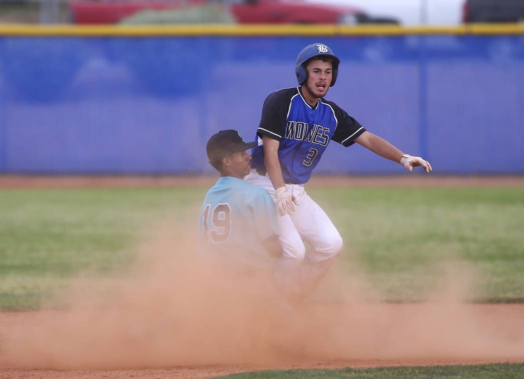 Basic's Roger Riley (3) makes it to second base against Silverado's Caleb Hubbard (19) during their first playoff game of the season at Basic High School in Henderson on Tuesday, May 9, 2017. Chas ...