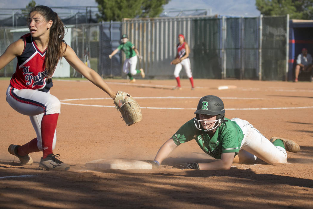 Rancho junior Gianna Carosone slides into third during the team's playoff game against Liberty at Liberty High School on Wednesday, May 10, 2017, in Henderson. Bridget Bennett Las Vegas Review-Jou ...