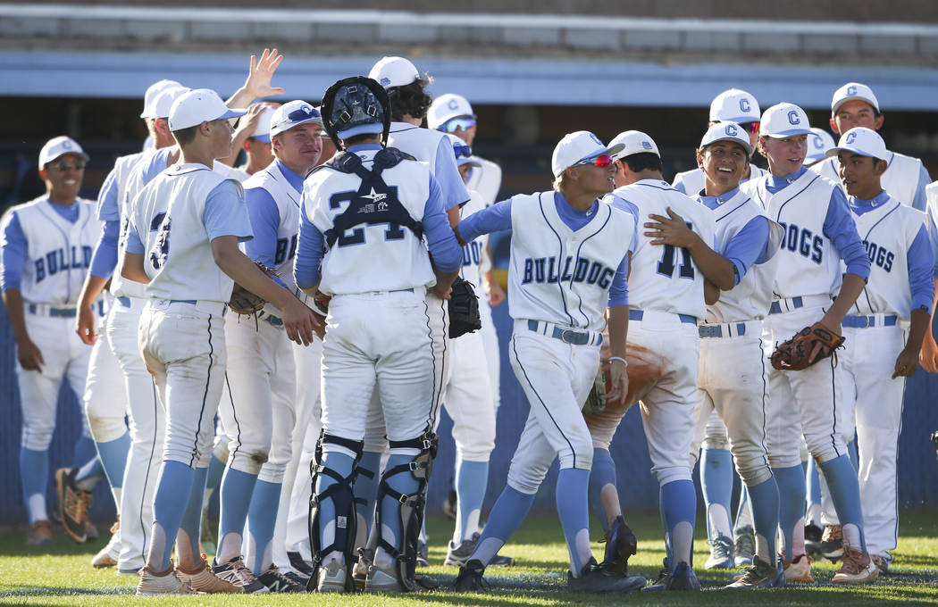 Centennial players celebrate after defeating Desert Oasis' 11-2 in a Sunset Region baseball tournament game at Centennial High School in Las Vegas on Wednesday, May 10, 2017. Chase Stevens Las Veg ...