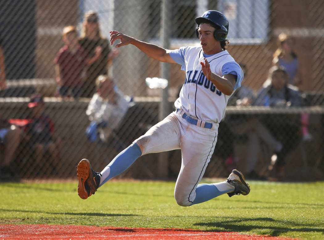 Centennial's Brett Berger slides into home base to score a run against Desert Oasis during a Sunset Region baseball tournament game at Centennial High School in Las Vegas on Wednesday, May 10, 201 ...
