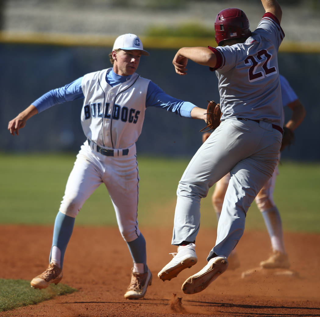 Centennial's Kian Wilbur tags out Desert Oasis' Chaison Miklich (22) between first and second base during a Sunset Region baseball tournament game at Centennial High School in Las Vegas on Wednesd ...