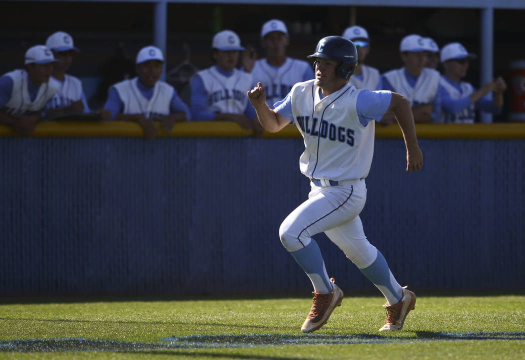 Centennial's Austin Kryszczuk heads for home base to score a run against Desert Oasis' during a Sunset Region baseball tournament game at Centennial High School in Las Vegas on Wednesday, May 10,  ...