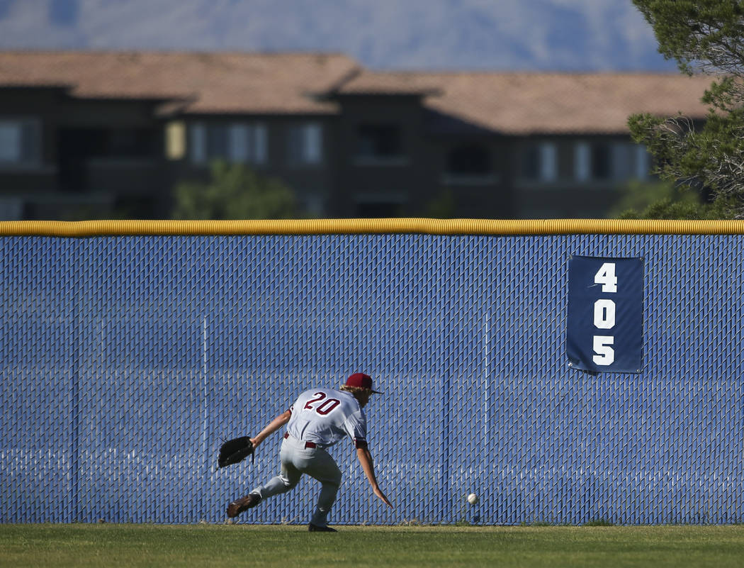 Desert Oasis' Jordan DeMarce (20) chases down a fly ball from Centennial during a Sunset Region baseball tournament game at Centennial High School in Las Vegas on Wednesday, May 10, 2017. Centenni ...