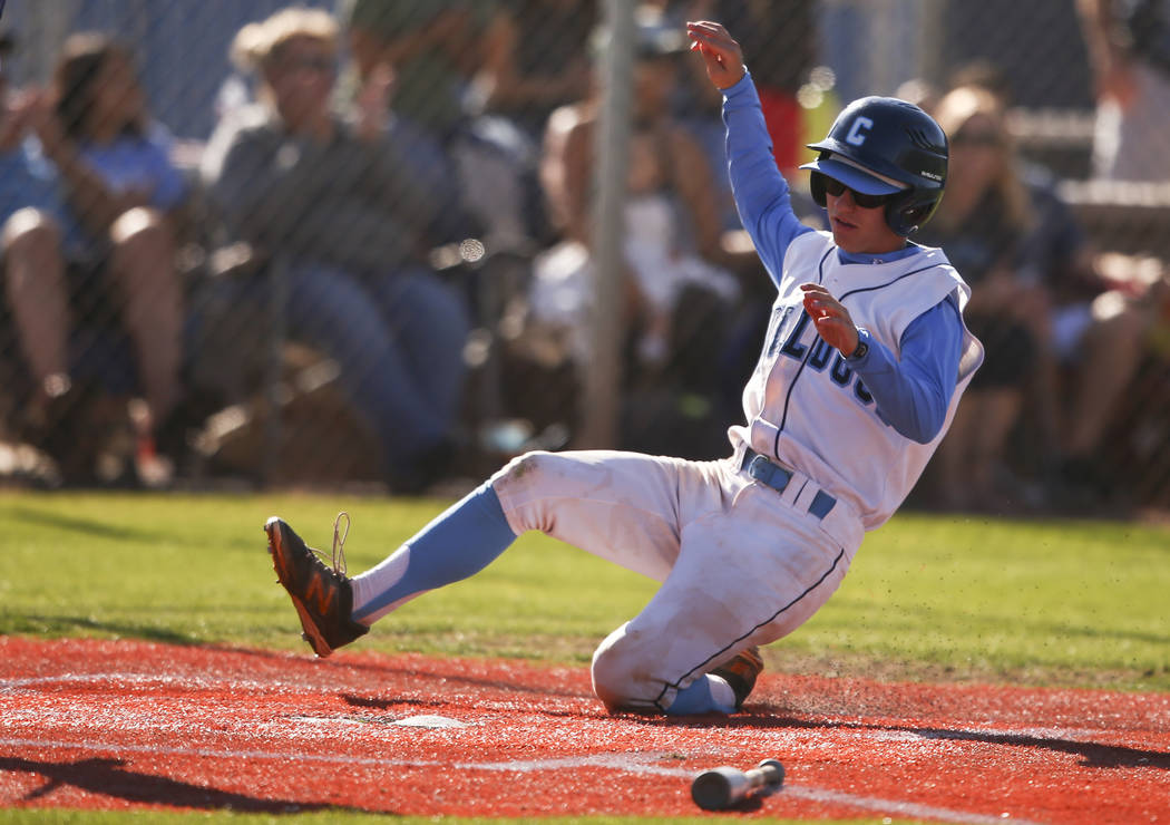 Centennial's Cole Sliwoski scores a run against Desert Oasis during a Sunset Region baseball tournament game at Centennial High School in Las Vegas on Wednesday, May 10, 2017. Centennial won 11-2. ...