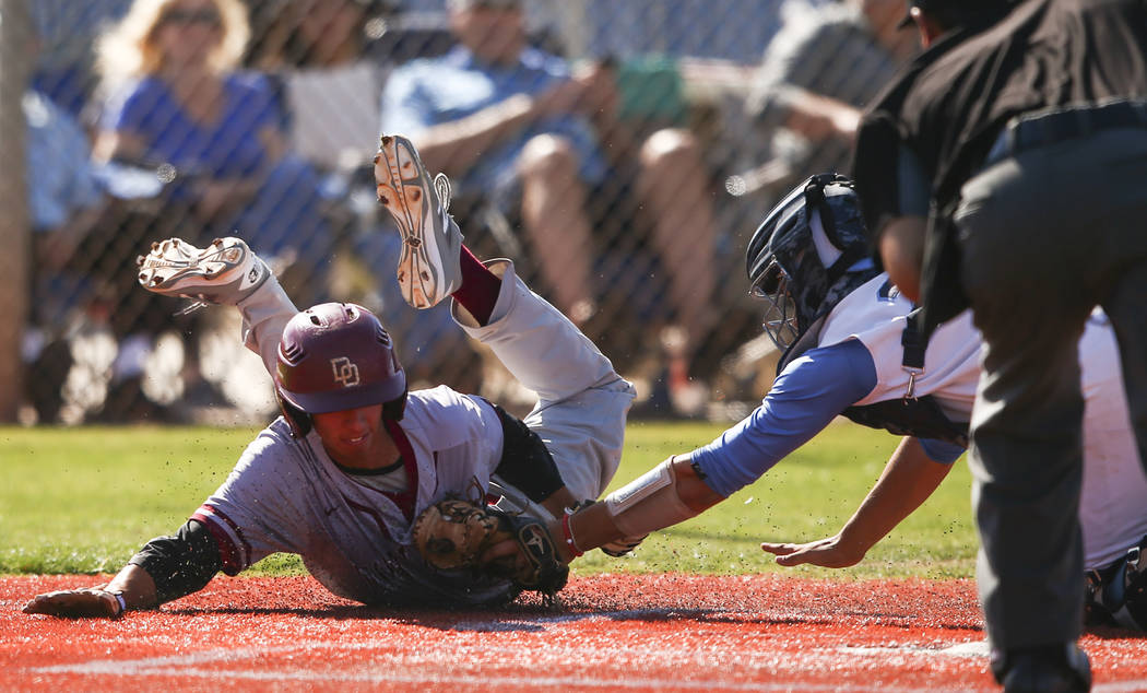 Desert Oasis' Kyle Fuentes, left, is tagged out by Centennial's Michael Jones during a Sunset Region baseball tournament game at Centennial High School in Las Vegas on Wednesday, May 10, 2017. Cen ...
