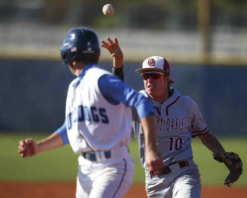 Desert Oasis' Cole Schaefer (10) chases down Centennial's Kian Wilbur for the tag during a Sunset Region baseball tournament game at Centennial High School in Las Vegas on Wednesday, May 10, 2017. ...