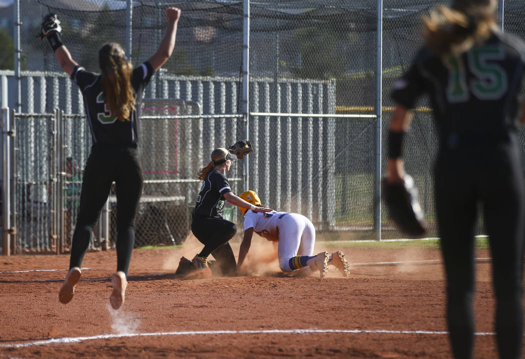 Palo Verde's Ally Snelling, second from left, tags out Sierra Vista's Ryan Watkins as Palo Verde's Taylor Askland (3) reacts during a Sunset Region softball tournament game at Palo Verde High Scho ...
