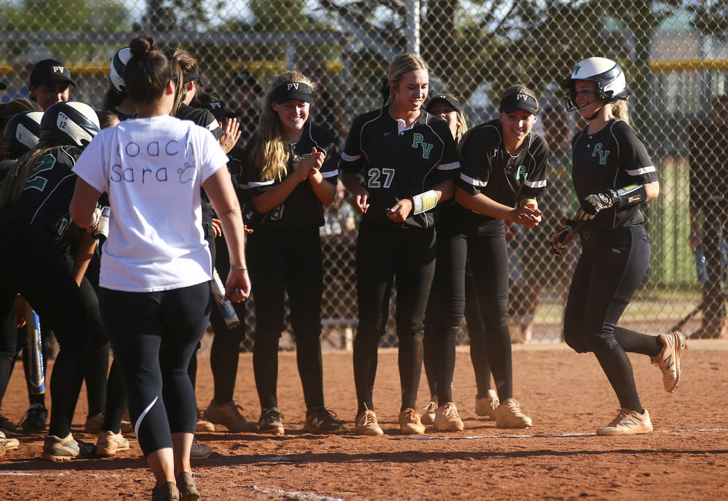 Palo Verde players celebrate a home run against Sierra Vista by Palo Verde's Lauryn Barker, right, during a Sunset Region softball tournament game at Palo Verde High School in Las Vegas on Thursda ...