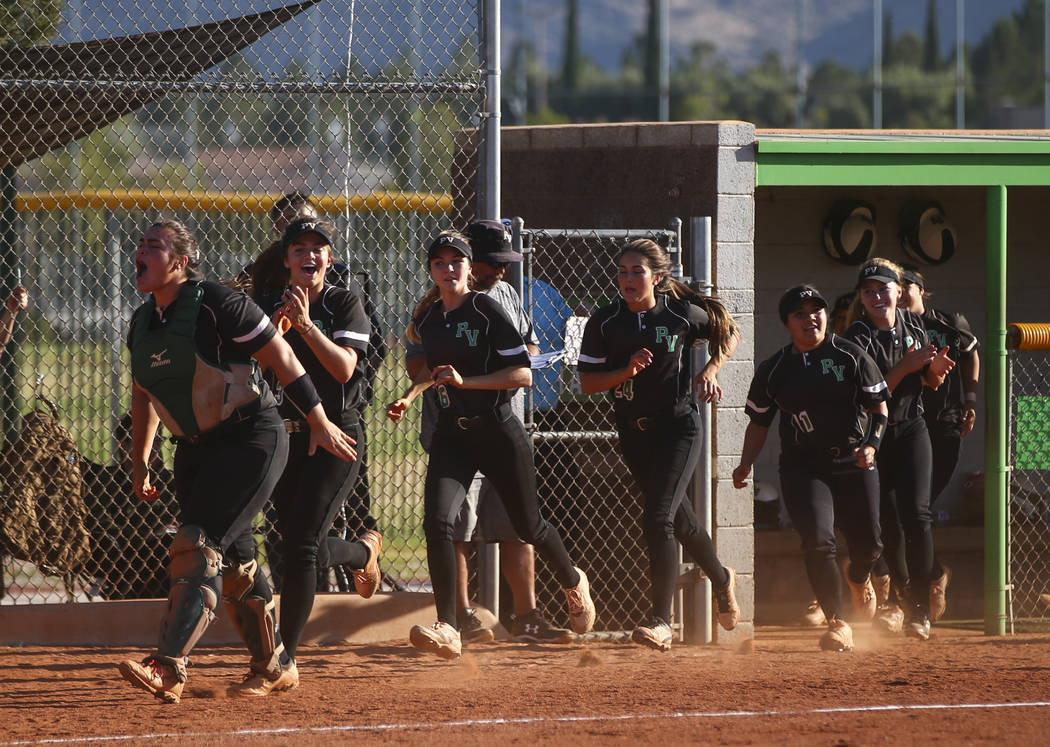 Palo Verde players react to a home run hit by Palo Verde's Lauryn Barker, not pictured, during a Sunset Region softball tournament game against Sierra Vista at Palo Verde High School in Las Vegas  ...