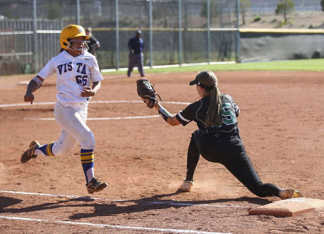 Sierra Vista's Taylore Edwards (66) gets tagged out at first base by Palo Verde's Makena Martin (15) during a Sunset Region softball tournament game at Palo Verde High School in Las Vegas on Thurs ...