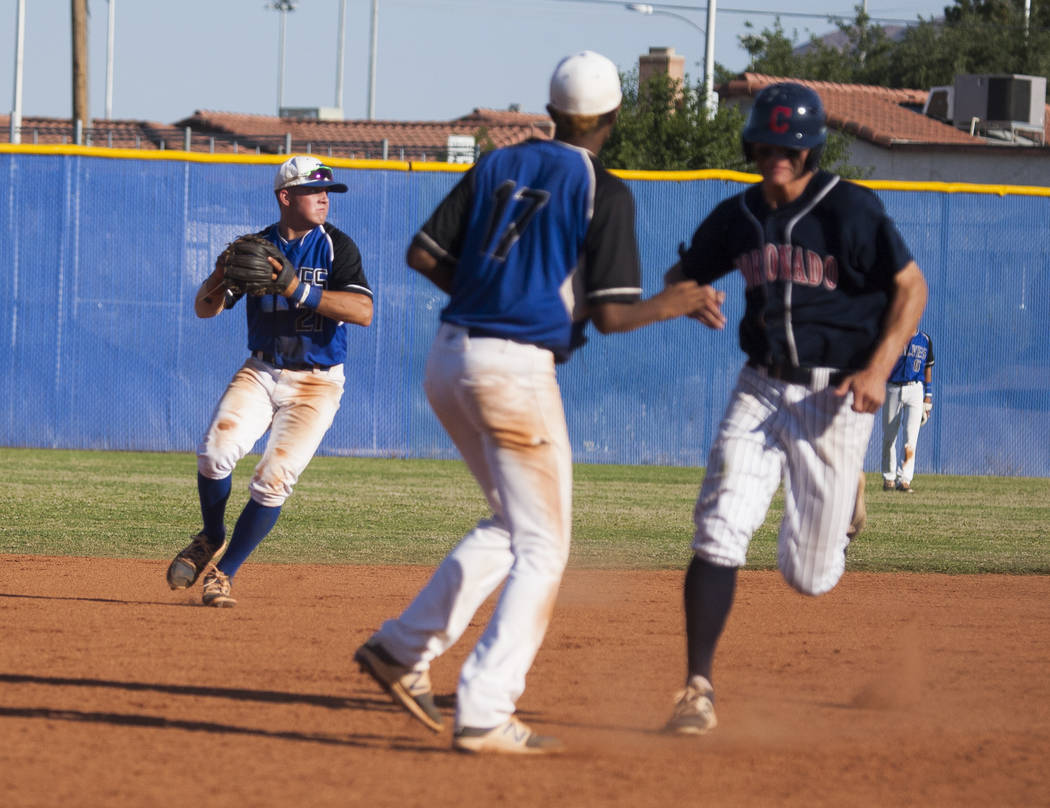 Basic looks to make a play at first against Coronado at Basic High School in Henderson on Thursday, May 11, 2017. Basic won 7-3. Patrick Connolly Las Vegas Review-Journal @PConnPie