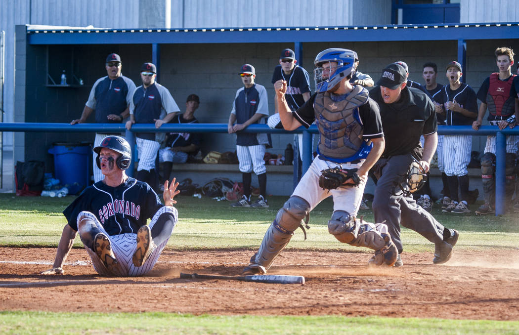 Basic catcher Roger Riley cheers after tagging Coronado's Ryan Murphy out at home plate at Basic High School in Henderson on Thursday, May 11, 2017. Basic won 7-3. Patrick Connolly Las Vegas Revie ...