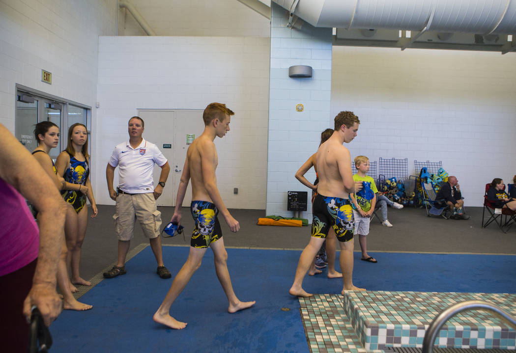 Moapa Valley freshman Spencer Raban, center left, prepares to compete in the 50m freestyle during a swim meet at Heritage Park Aquatic Complex in Henderson on Saturday, April 29, 2017. Chase Steve ...
