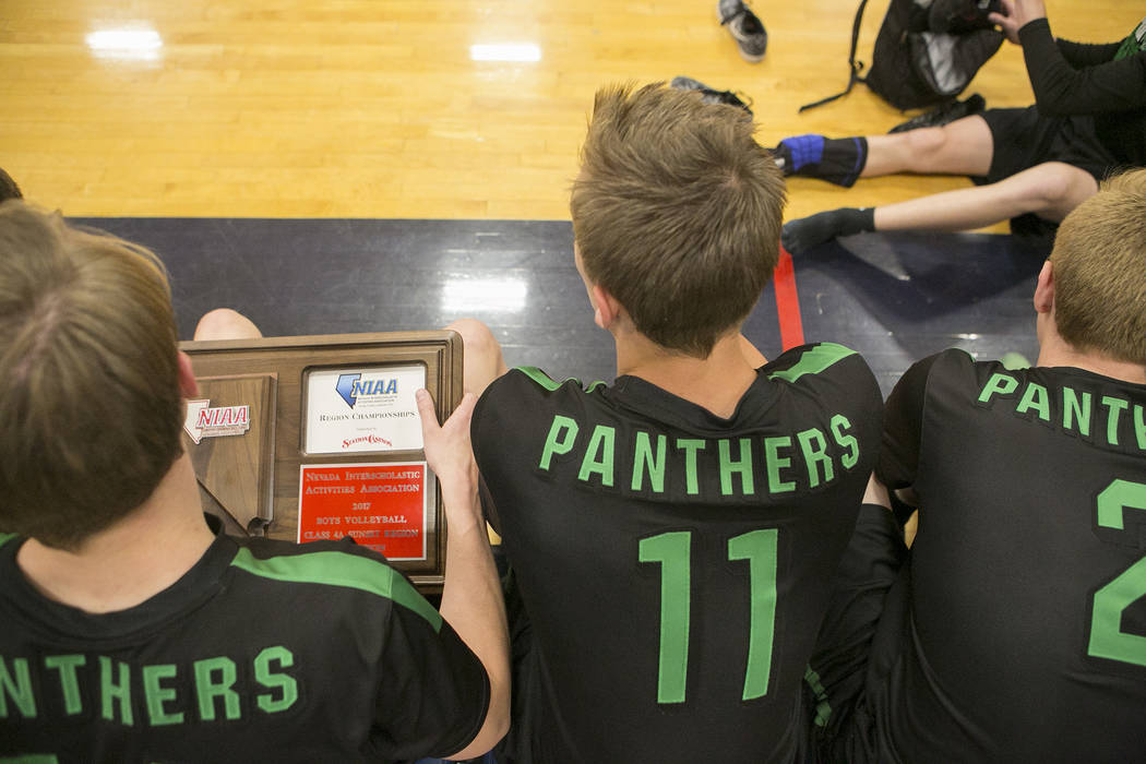 Palo Verde senior Josh Horn (14), left, holds a plaque after the teams win over Coronado at Coronado High School Friday, May 12, 2017 in Henderson. Palo Verde won 3-1, making them the Sunset Regio ...