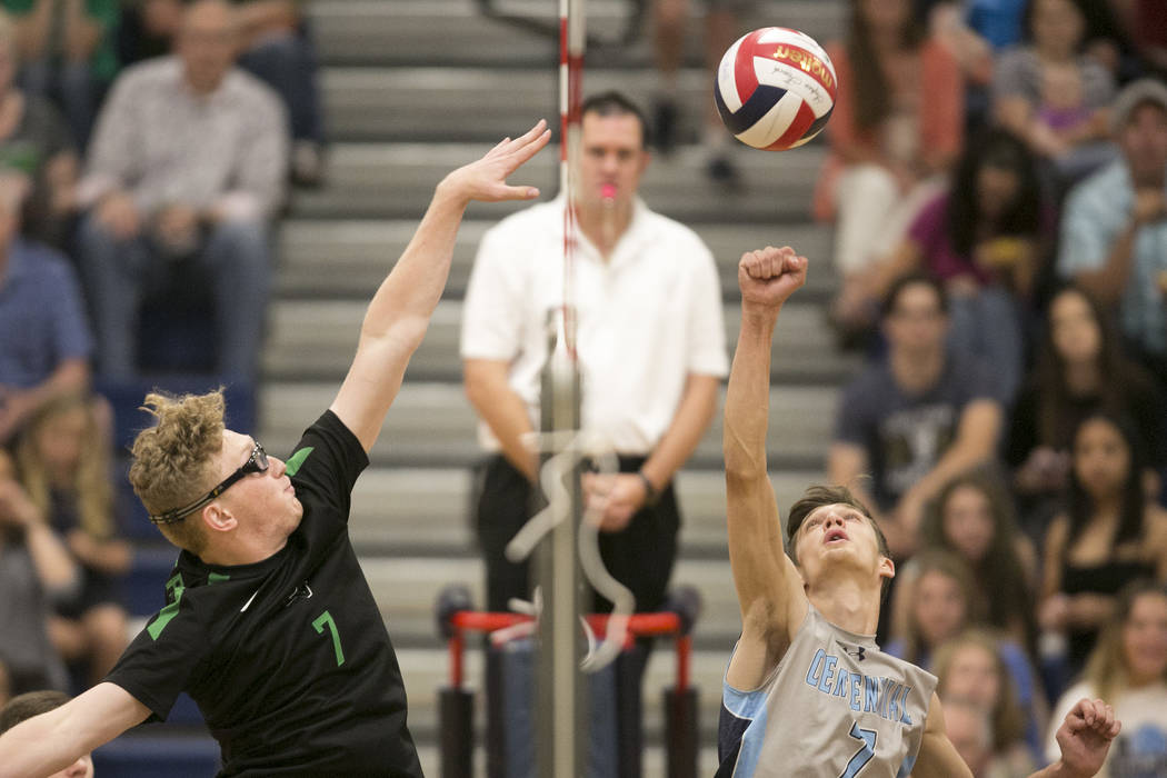 Palo Verde senior Grant Tingey (7), left, attempts to block Coronado sophomore Alex White's (7), right, hit during a match for the Sunset Region volleyball finals at Coronado High School Friday, M ...