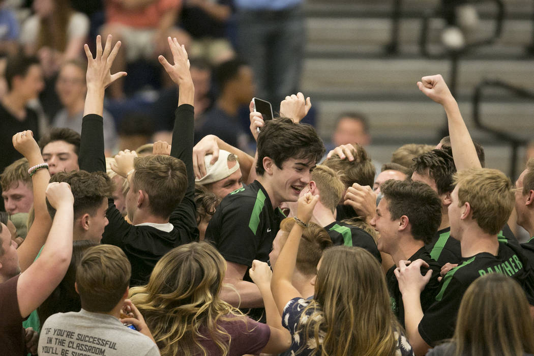 Palo Verde fans storm the court to celebrate the team's win over Coronado for the Sunset Region volleyball finals at Coronado High School Friday, May 12, 2017, in Henderson. Palo Verde won 3-1, ma ...