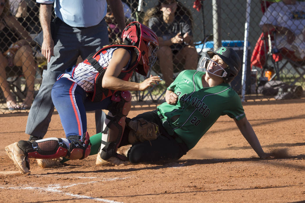 Rancho's MacKenzie Perry (20) is tagged out at home plate against Liberty's Kylie Hefley (15) at Foothill High School on Friday, May 12, 2017 in Henderson. Rancho won 3-1. Erik Verduzco Las Vegas  ...