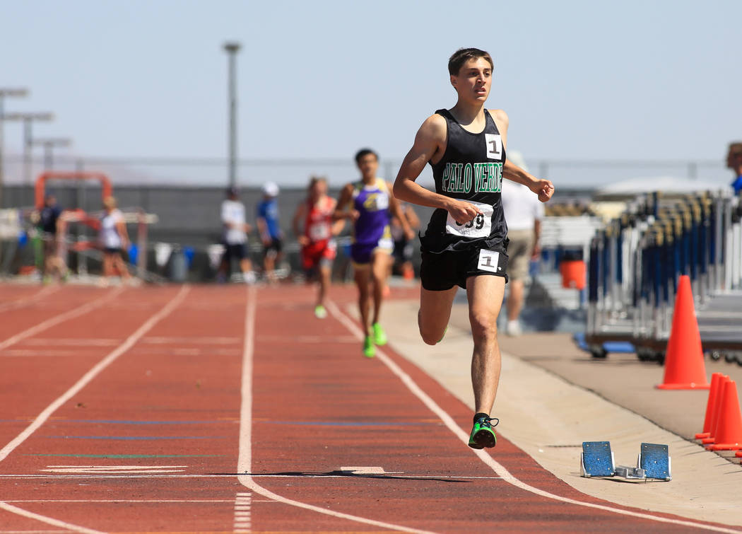 Daniel Ziems, of Palo Verde High School, crosses the finish line to win the boy's 1600 meter Sunset Region final during the Sunset and Sunrise Region track meet at Foothill High School in Henderso ...