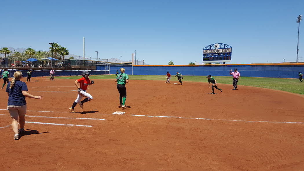 Coronado's Ashley Ward is unable to beat the throw to first after grounding out to end the third inning in the Class 4A Sunrise Region softball championship Saturday at Bishop Gorman. (David Schoe ...